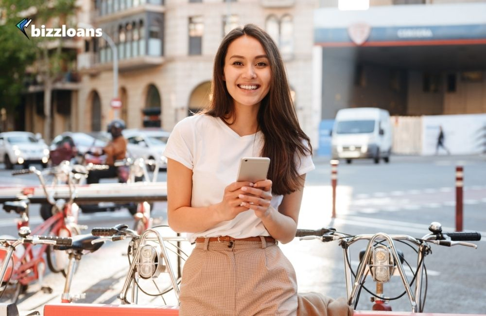 smiling beautiful woman paying with smartphone